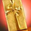 Stock Photo: Gift box against gradient