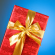 Gift box against gradient — Stock Photo