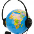 Headset on globe isolated - Stock Photo