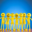 Leadership concept with smilies - Stock Photo