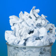 Stock Photo: Garbage bin with paper waste