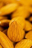 Fresh almonds arranged on the white — Stock Photo