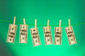 Money laundering concept with dollars — Stock Photo