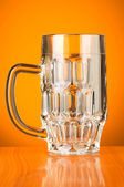 Beer glass against gradient — Stock Photo