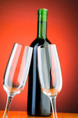 Wine glasses against background — Stock Photo