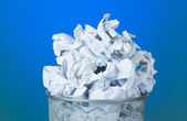 Garbage bin with paper waste — Stock Photo