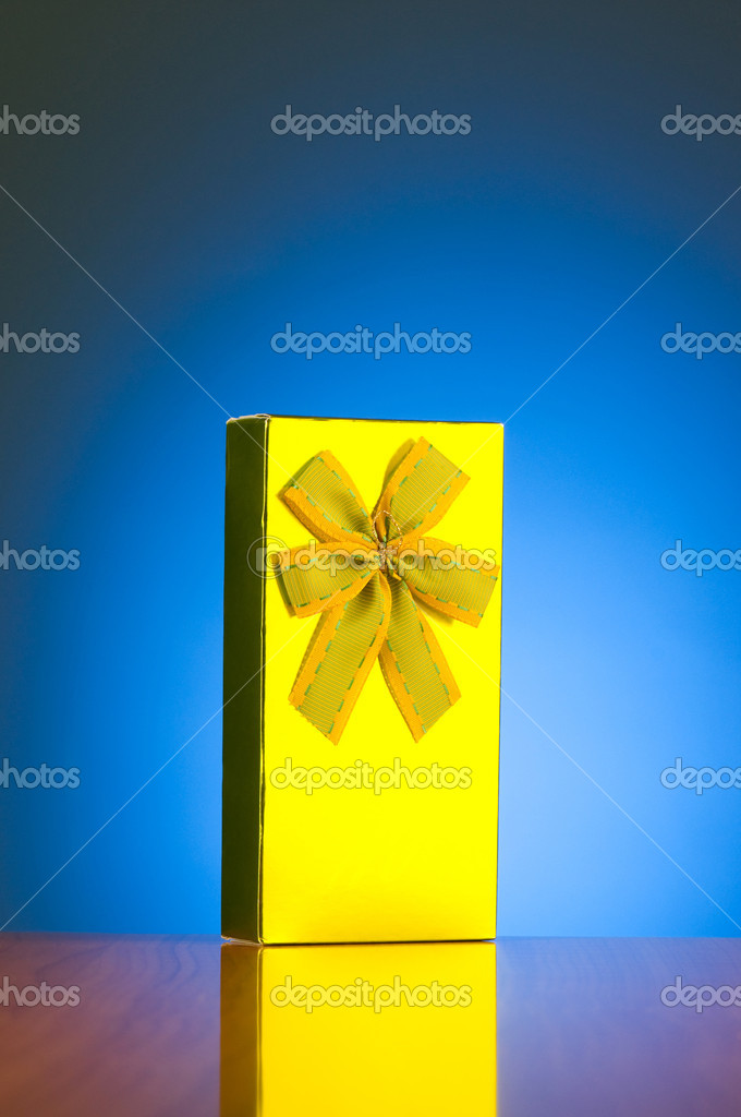 Gift box against gradient background — Stock Photo #2876793