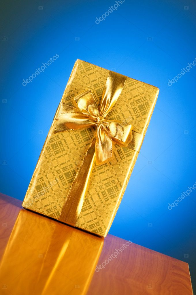 Gift box against gradient background — Stock Photo #2876797