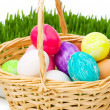 Stock Photo: Eggs in the basket and grass isolated