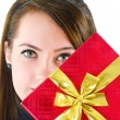 Young woman with red gift box — Stock Photo