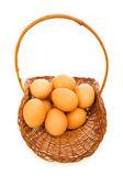 Basket full of eggs isolated on white — Stock Photo