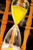 Wooden hourglass isolated on the black — Stock Photo