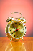 Alarm clock against colourful background — Stock Photo