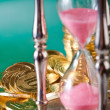 Hourglass and coins — Stock Photo #3896817