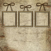 Frames with bow on grunge background — Stok fotoğraf