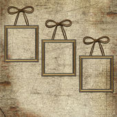 Frames with bow on grunge background — Stock Photo