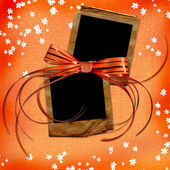 Orange card with old slides and bow — Stock Photo