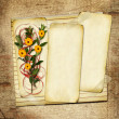 Card with bouquet on old grunge background — Stock Photo