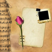 Grunge paper with rose on musical — Stock Photo