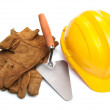 Yellow hardhat and old leather gloves isolated — Stock Photo
