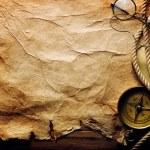 kompass, seil und gläser auf dem alten papier — Stockfoto