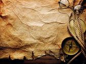 Kompas, lana a brýle na starý papír — Stock fotografie