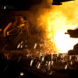 Molten liquid iron is poured. - Stock Photo