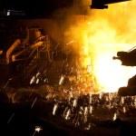 Molten liquid iron is poured. — Stock Photo #5123095