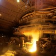 Molten liquid iron is poured. — Stock Photo #5123132