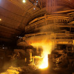 Molten liquid iron is poured. — Stock Photo