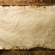 Old paper on wood board — Stock Photo