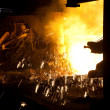 Molten liquid iron is poured. — Stock Photo