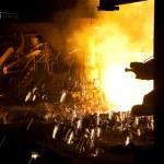Molten liquid iron is poured. — Stock Photo #5124715