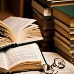 Opened book, lying on the bookshelf — Stock Photo #5126432