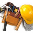 Stock Photo: Yellow helmet and different tools isolated