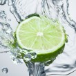 Royalty-Free Stock Photo: Lime in spray of water.