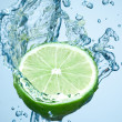 Lime in spray of water. — Stock Photo