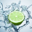 Lime in spray of water. — Stock Photo #5129317