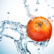 Tomato in spray of water. — Stock Photo