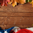 Background with colored leaves on wooden board — Stock Photo