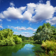 Summer landscape, river and blue sky — Stock Photo