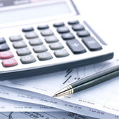 Financial concept. Calculator and pen. — Stock Photo