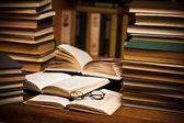 Opened book, lying on the bookshelf — Stock Photo