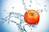 Tomato in spray of water. — Stock Photo