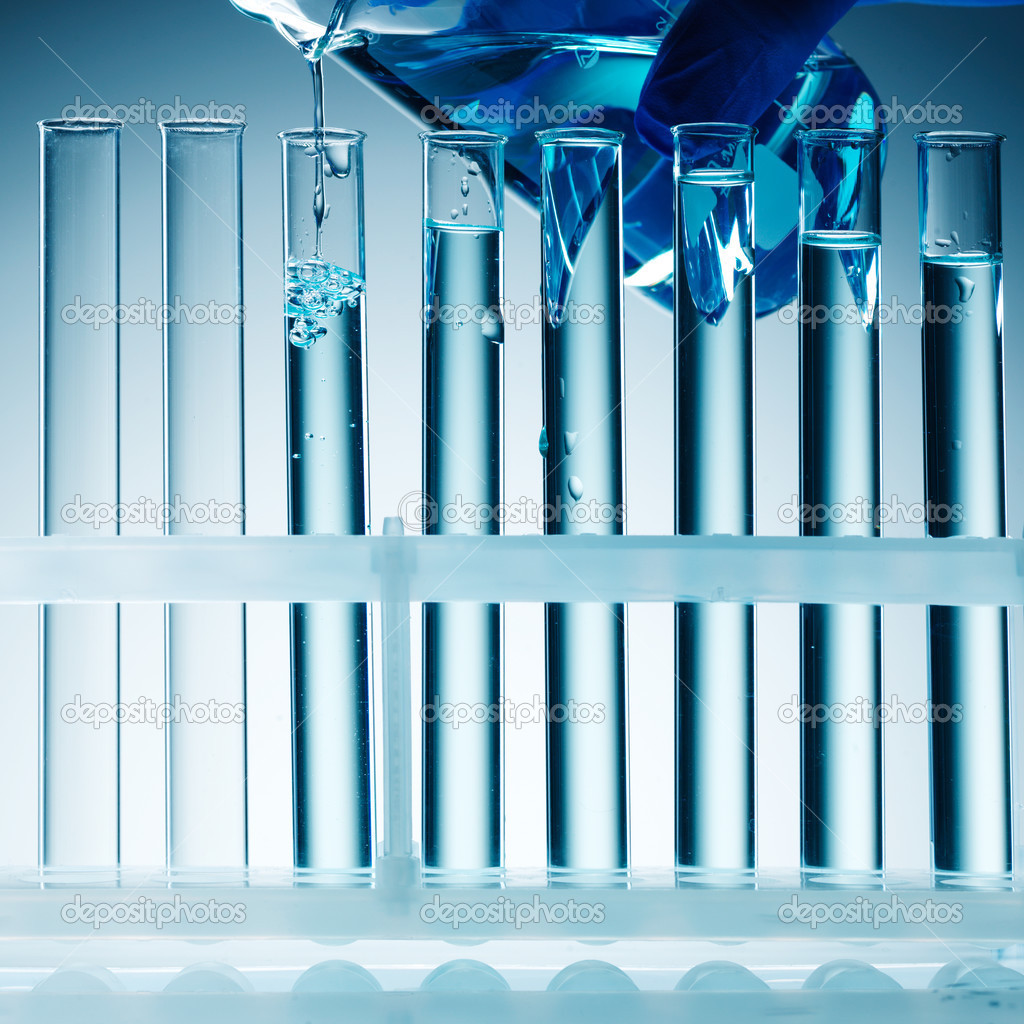 Close up view of Test Tubes on blue — Stock Photo #5120897