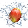 Mango in spray of water. — Stock Photo