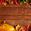 Background with colored leaves on wooden board — Stock Photo #5131072