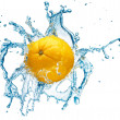 Orange in spray of water. - Photo