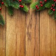 Christmas fir tree on wooden board — Stock Photo