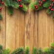 Christmas fir tree on wooden board — Zdjęcie stockowe #5137594